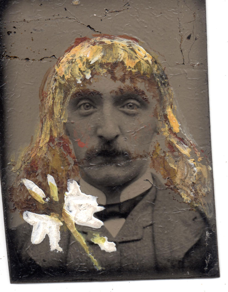 Hand-painted gem tintype Unknown photographer Date unknown Gem tintype Sheila Masson Collection The application of paint to this unmounted gem tintype reveals a sense of humour not typically seen in Victorian portraiture. The flowing golden locks and what might be a flower or a winged insect on the lapel create an amusing miniature portrait, but was this addition made by the subject himself or by someone else?